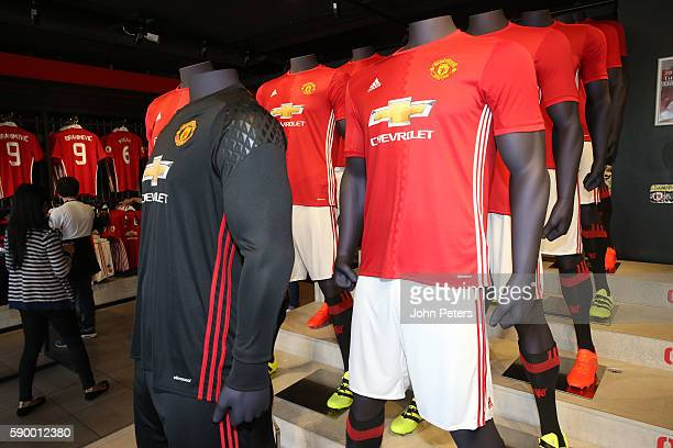 A general view of the 2016/17 home kit on sale at the Manchester United Megastore at Old Trafford on August 11 2016 in Manchester England