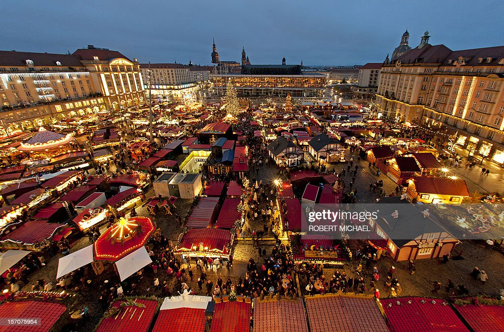 A general view of the 578th so-called Striezel Christmas market just after its opening on November 28, 2012 in Dresden, eastern Germany. Visitors of the Christmas market can buy the traditional Striezel or Stollen fruit loaf, hot punch, gingerbread and craftwork at around 240 market stands up to Christmas Eve. Striezel (or Stollen), a fruit loaf made of yeast dough, almonds, raisins and other ingredients, is a culinary specialty of the eastern German town. MICHAEL