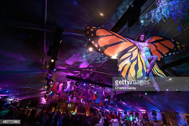 A general view of the acrobatic dancers performing over the guests during the annual Midsummer Night's Dream Party at the Playboy Mansion hosted by...
