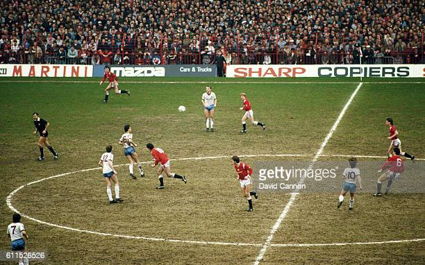 A general view of the action and the muddy Old Trafford pitch during a 6th Round FA Cup match between Manchester United and West Ham United at Old...