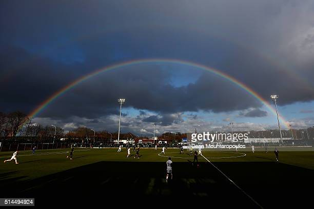 A general view of the action as a rainbow forms in the sky during the UEFA Youth League Quarterfinal match between Paris Saint Germain and AS Roma at...