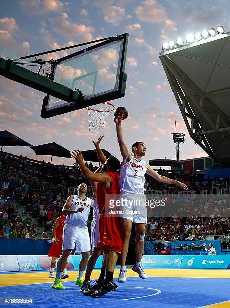 A general view of the action as Aleksandr Pavlov of Russia jumps at the basket during the Men's 3x3 Basketball gold medal match between Russia and...