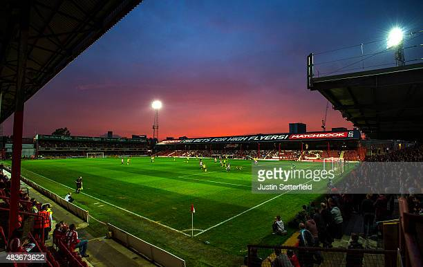 A general view of the action at sunset during the Capital One Cup First Round match between Brentford and Oxford United at Griffin Park on August 11...