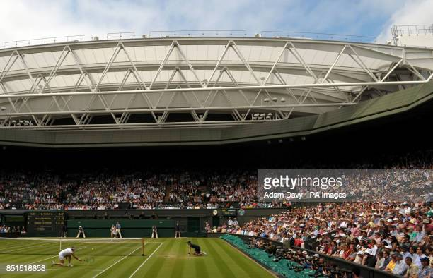 General view of the action on centre court as Belgium's Kirsten Flipkens plays against France's Marion Bartoli during day ten of the Wimbledon...