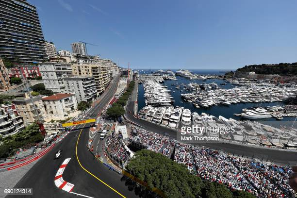 A general view of the action showing Felipe Massa of Brazil driving the Williams Martini Racing Williams FW40 Mercedes Pascal Wehrlein of Germany...