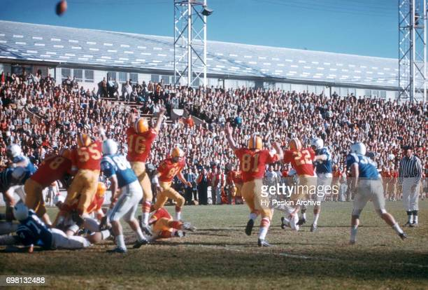 General view of the Air Force Falcons kicking the ball for a field goal as the Denver Pioneers try to block during an NCAA game on November 8 1958 at...