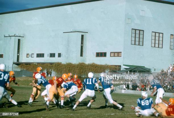 General view of the Air Force Falcons running the ball as the Denver Pioneers play defense during an NCAA game on November 8 1958 at DU Stadium in...