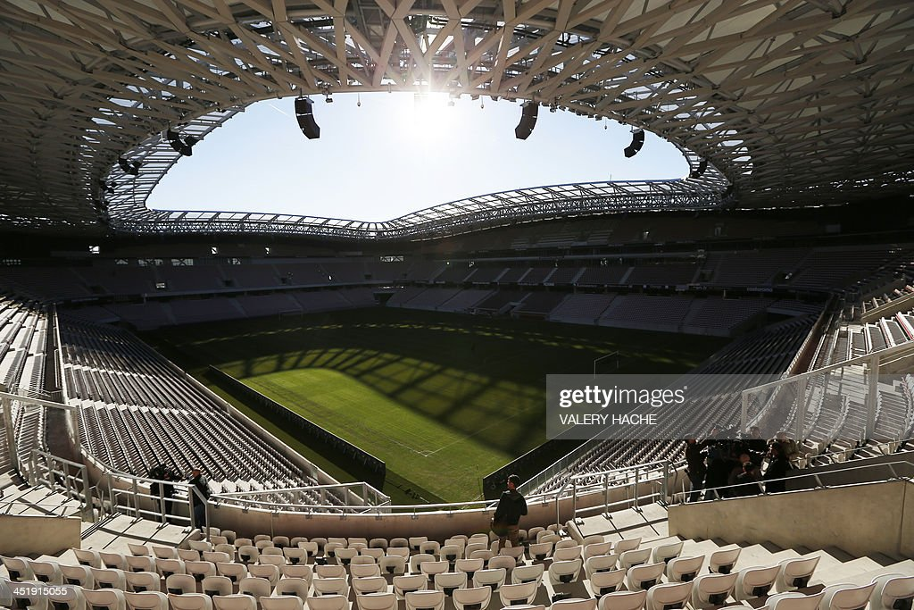 A general view of the Allianz Riviera stadium as Xavier Lortat-Jacob, president of the Nice Eco-Stadium, (R) speaks to journalists on the tribune's balcony after an investigation has been launched into the violence that surrounded Sunday's French Ligue 1 match between Nice and Saint-Etienne, on November 25, 2013 in Nice, southeastern France. Eight people were hurt after fans from the two sides tore up seats inside the Allianz Riviera stadium in Nice and hurled them at each other.