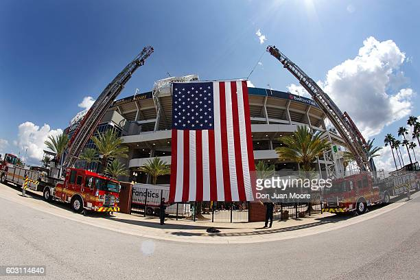 A general view of the American Flag outside the stadium in between two fire trucks before the game between of the Jacksonville Jaguars and the Green...