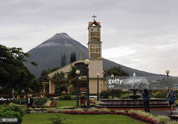 General view of the Arenal vulcano at the back of La Fortuna church on July 29 2008 in La Fortuna some 80 km northeast of San Jose Forty years after...