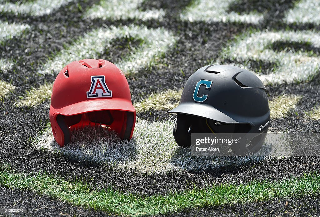 A general view of the Arizona Wildcats and the Coastal Carolina Chanticleers batting helmets prior to the start of game three of the College World Series Championship Series on June 30, 2016 at TD Ameritrade Park in Omaha, Nebraska.