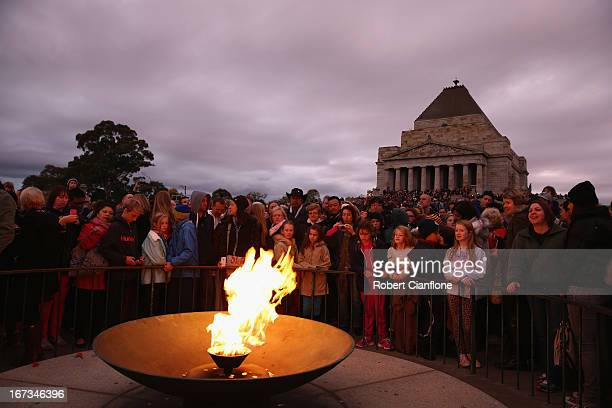 A general view of the assembled crowd around the Eternal Flame at the dawn service on April 25 2013 in Melbourne Australia Veterans dignitaries and...