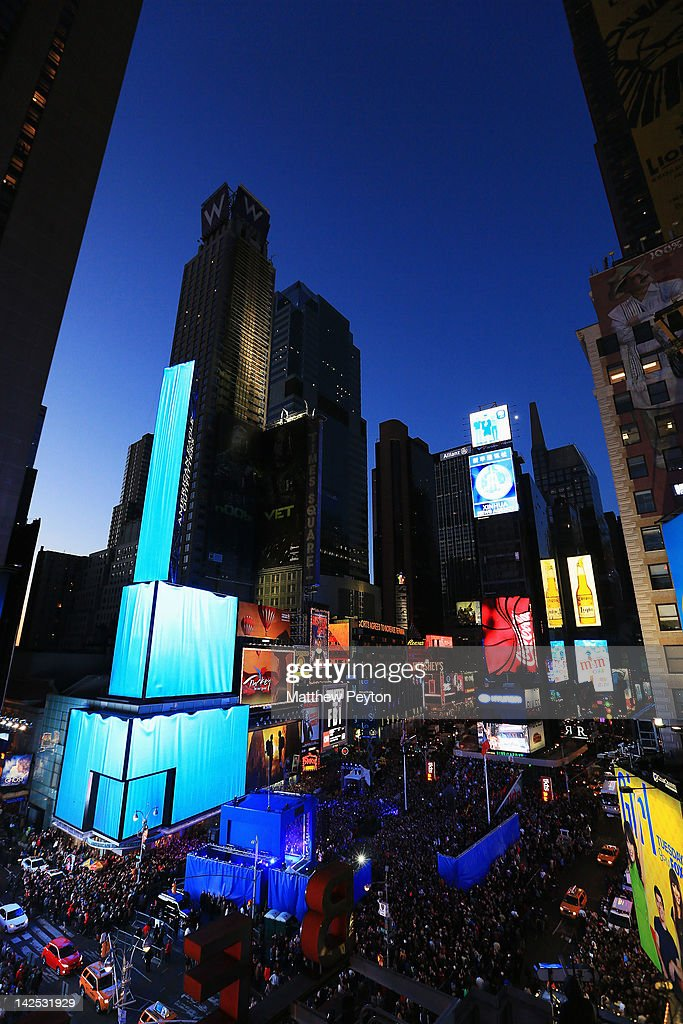 "A general view of the atmosphere as Times Square was brought to a standstill on April 6, 2012 as Nicki Minaj teamed up with Nokia to perform live for the launch of the Windows Phone-based Nokia Lumia 900 in North America, in New York City. Tens of thousands of people watched Nicki perform a medley of her hits before a prominent Times Square building was turned into a living, breathing entity in time to the unique Nokia Lumia 900 remix of her hit single 'Starships'. The building appeared to fill with water before a 60ft waterfall was seen to cascade down the side of the building. The reaction of the crowd was shown on nine massive electronic screens around the famous square making it one of the biggest LED displays ever seen and will be used in the video of Nicki's new Nokia Lumia 900 remix of 'Starships'. ""When Nokia came to me with the idea to make a building come alive and to perform in Times Square in front of my fans to celebrate the launch of the Nokia Lumia 900 there was only ever one answer. To see the idea on paper was amazing but to see it for real blew me away. It brought Times Square to a standstill. The absolute bonus for me is that my fans, who have been so loyal to me, are now part of the video for the Starships Nokia remix. Performing in my home town of NYC the same week as the release of my new album, Pink Friday: Roman Reloaded is amazing and it really is a dream come true."" The Nokia Lumia 900 will be available in unique and eye-catching cyan blue and a matte black with a new high-gloss white version on sale later this month. To watch more of the amazing event go to www.facebook.com/nokiaus"