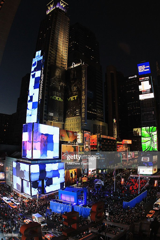 """A general view of the atmosphere as Times Square was brought to a standstill on April 6, 2012 as Nicki Minaj teamed up with Nokia to perform live for the launch of the Windows Phone-based Nokia Lumia 900 in North America, in New York City. Tens of thousands of people watched Nicki perform a medley of her hits before a prominent Times Square building was turned into a living, breathing entity in time to the unique Nokia Lumia 900 remix of her hit single 'Starships'. The building appeared to fill with water before a 60ft waterfall was seen to cascade down the side of the building. The reaction of the crowd was shown on nine massive electronic screens around the famous square making it one of the biggest LED displays ever seen and will be used in the video of Nicki's new Nokia Lumia 900 remix of 'Starships'. """"When Nokia came to me with the idea to make a building come alive and to perform in Times Square in front of my fans to celebrate the launch of the Nokia Lumia 900 there was only ever one answer. To see the idea on paper was amazing but to see it for real blew me away. It brought Times Square to a standstill. The absolute bonus for me is that my fans, who have been so loyal to me, are now part of the video for the Starships Nokia remix. Performing in my home town of NYC the same week as the release of my new album, Pink Friday: Roman Reloaded is amazing and it really is a dream come true."""" The Nokia Lumia 900 will be available in unique and eye-catching cyan blue and a matte black with a new high-gloss white version on sale later this month. To watch more of the amazing event go to www.facebook.com/nokiaus"""