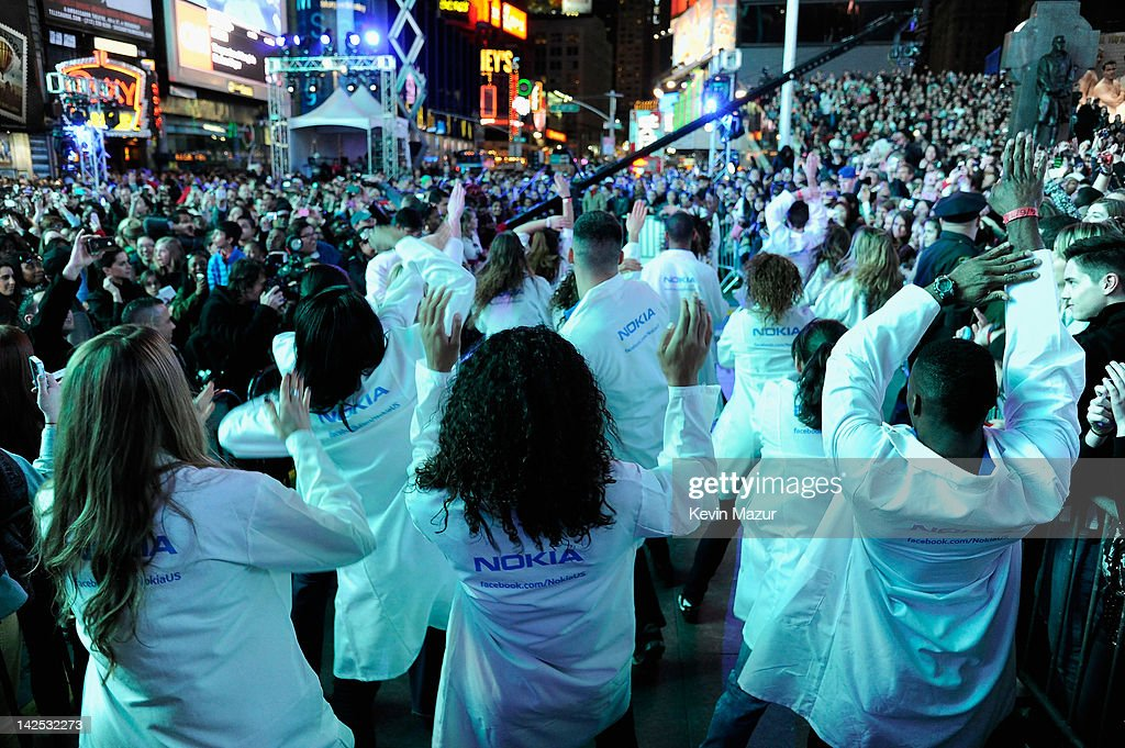 "A general view of the atmosphere as Times Square was brought to a standstill on April 6, 2012 as <a gi-track='captionPersonalityLinkClicked' href=/galleries/search?phrase=Nicki+Minaj+-+Performer&family=editorial&specificpeople=6362705 ng-click='$event.stopPropagation()'>Nicki Minaj</a> teamed up with Nokia to perform live for the launch of the Windows Phone-based Nokia Lumia 900 in North America, in New York City. Tens of thousands of people watched Nicki perform a medley of her hits before a prominent Times Square building was turned into a living, breathing entity in time to the unique Nokia Lumia 900 remix of her hit single 'Starships'. The building appeared to fill with water before a 60ft waterfall was seen to cascade down the side of the building. The reaction of the crowd was shown on nine massive electronic screens around the famous square making it one of the biggest LED displays ever seen and will be used in the video of Nicki's new Nokia Lumia 900 remix of 'Starships'. ""When Nokia came to me with the idea to make a building come alive and to perform in Times Square in front of my fans to celebrate the launch of the Nokia Lumia 900 there was only ever one answer. To see the idea on paper was amazing but to see it for real blew me away. It brought Times Square to a standstill. The absolute bonus for me is that my fans, who have been so loyal to me, are now part of the video for the Starships Nokia remix. Performing in my home town of NYC the same week as the release of my new album, Pink Friday: Roman Reloaded is amazing and it really is a dream come true."" The Nokia Lumia 900 will be available in unique and eye-catching cyan blue and a matte black with a new high-gloss white version on sale later this month. To watch more of the amazing event go to www.facebook.com/nokiaus"