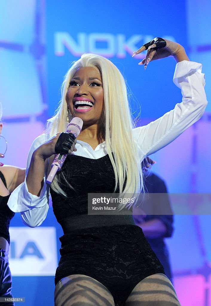 """A general view of the atmosphere as Times Square was brought to a standstill on April 6, 2012 as <a gi-track='captionPersonalityLinkClicked' href=/galleries/search?phrase=Nicki+Minaj+-+Performer&family=editorial&specificpeople=6362705 ng-click='$event.stopPropagation()'>Nicki Minaj</a> teamed up with Nokia to perform live for the launch of the Windows Phone-based Nokia Lumia 900 in North America, in New York City. Tens of thousands of people watched Nicki perform a medley of her hits before a prominent Times Square building was turned into a living, breathing entity in time to the unique Nokia Lumia 900 remix of her hit single 'Starships'. The building appeared to fill with water before a 60ft waterfall was seen to cascade down the side of the building. The reaction of the crowd was shown on nine massive electronic screens around the famous square making it one of the biggest LED displays ever seen and will be used in the video of Nicki's new Nokia Lumia 900 remix of 'Starships'. """"When Nokia came to me with the idea to make a building come alive and to perform in Times Square in front of my fans to celebrate the launch of the Nokia Lumia 900 there was only ever one answer. To see the idea on paper was amazing but to see it for real blew me away. It brought Times Square to a standstill. The absolute bonus for me is that my fans, who have been so loyal to me, are now part of the video for the Starships Nokia remix. Performing in my home town of NYC the same week as the release of my new album, Pink Friday: Roman Reloaded is amazing and it really is a dream come true."""" The Nokia Lumia 900 will be available in unique and eye-catching cyan blue and a matte black with a new high-gloss white version on sale later this month. To watch more of the amazing event go to www.facebook.com/nokiaus"""