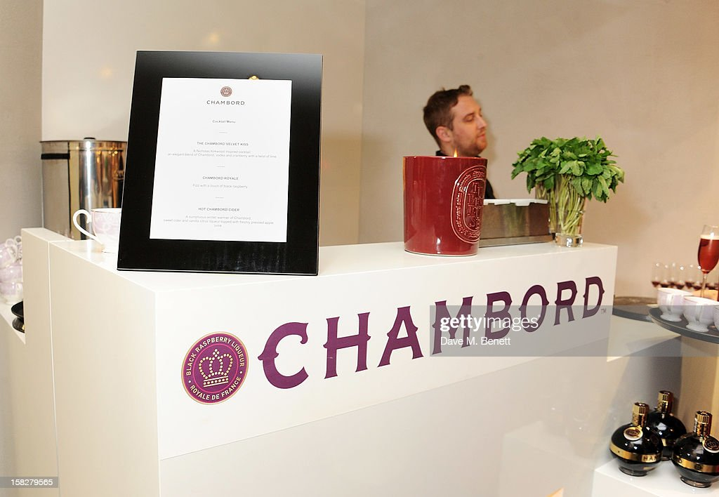 A general view of the atmosphere at a Christmas drinks hosted by designer Nicholas Kirkwood to celebrate his partnership with Chambord black raspberry liquer, and launch the limited edition shoe 'The Chambord' at the Nicholas Kirkwood Mount Street store on December 12, 2012 in London, England.