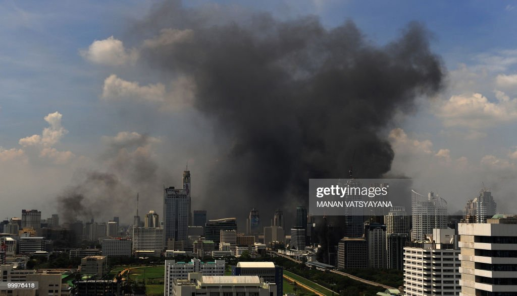A general view of the Bangkok skyline shows smoke rising into the air following a crackdown by Thai Army soldiers on the Red Shirt anti-government protesters' camp in Bangkok on May 19, 2010. A curfew is to be imposed across Bangkok on night, defence minister General Prawit Wongsuwon said after a military offensive against anti-government protesters in the capital.