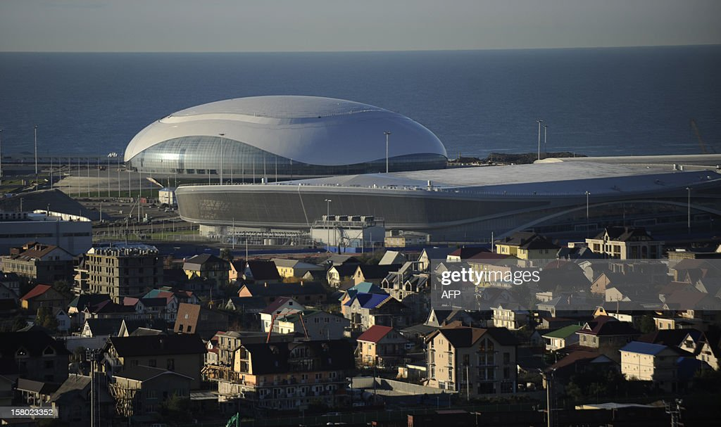 A general view of the Bolshoi Ice Palace and Speed Skating Stadium construction site at the Olympic Park in the Russian Black Sea resort of Sochi, , on December 9, 2012. The Olympic Park will be able to accommodate about 75000 visitors when full, and all the ice arenas will be within walking distance of one other. Sochi will host the 2014 Winter Olympics. AFP PHOTO / MIKHAIL MORDASOV