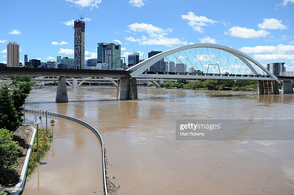 A general view of the Brisbane river as it passes the high tide peak as parts of southern Queensland experiences record flooding in the wake of Tropical Cyclone Oswald on January 29, 2013 in Brisbane, Australia. The river in the Brisbane CBD is expected to peak at 2.3 metres today - lower than the 2.6 metre peak predicted - but is still likely to flood low-lying properties and businesses. The flood crisis has claimed four lives so far, with the city of Bundaberg, Queensland faces the worst flooding in its history.