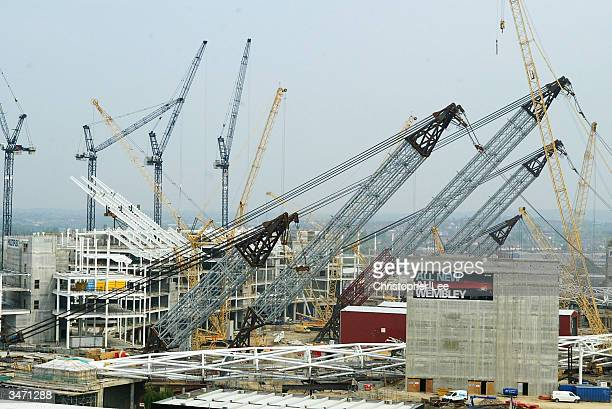 General view of the building work showing the Great Arch which will be the new landmark of Wembley Stadium positioned on the ground with the cranes...