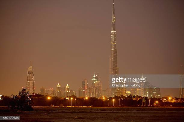 A general view of the Burj Khalifa the worlds tallest tower as morning breaks over the city skyline of Dubai on November 17 2013 in Dubai United Arab...
