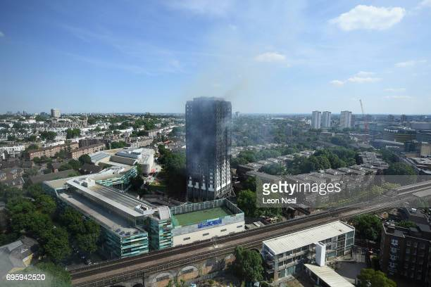 A general view of the burning 24 storey residential Grenfell Tower block in Latimer Road West London on June 14 2017 in London England The Mayor of...
