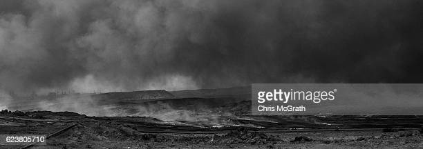 A general view of the burnt landscape scorched by airstrikes and covered in ash and oil from burning oil wells set on fire by fleeing ISIS members on...