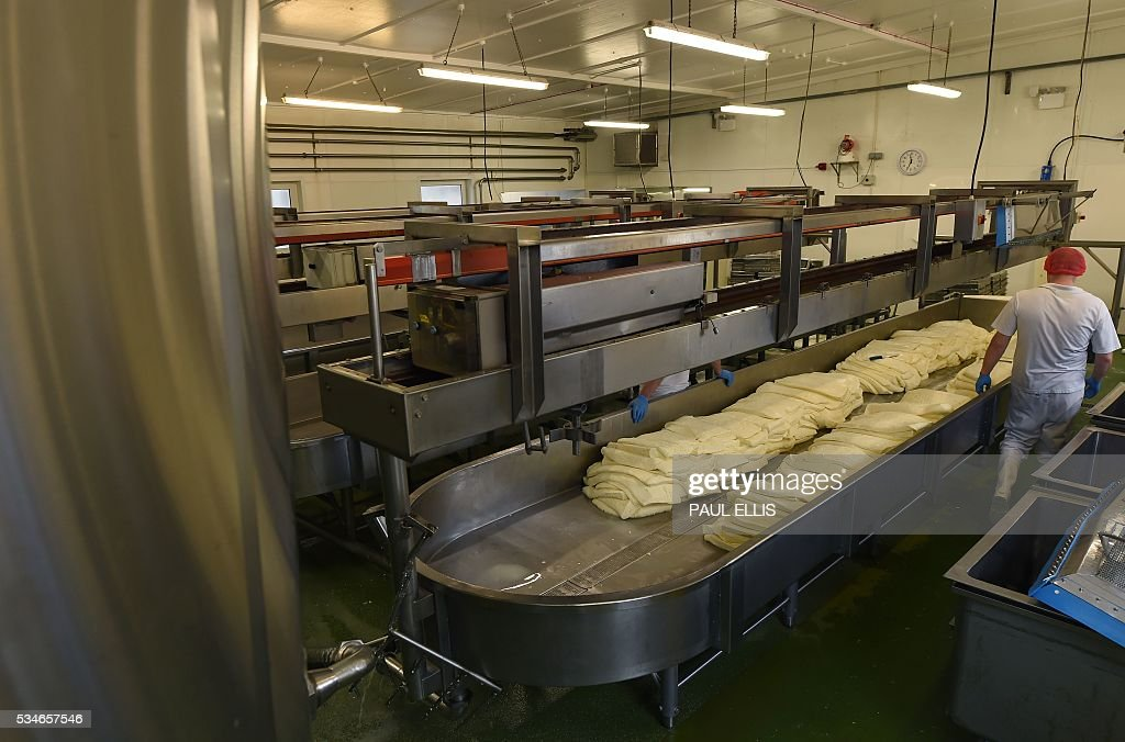 A general view of the cheese-making facility inside Singleton's Dairy is seen during the vists by John Longworth, former Director-General of the British Chambers of Commerce, and current Chairman of the 'Vote Leave' Business Council, the official 'Leave' campaign organisation for the forthcoming EU referendum, in Preston, north-west England, on May 27, 2016. Campaigners for a 'Leave' vote in Britain's EU referendum launched an online competition and poll Friday offering £50 million for anyone who correctly predicts the outcome of every Euro 2016 fixture. The Vote Leave campaign said it had chosen the prize amount for the European football championships because it was equivalent to the sum that Britain contributes to the European Union budget every day. / AFP / PAUL