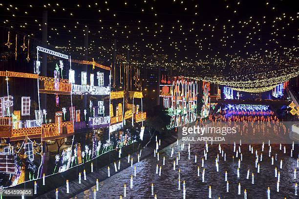 A general view of the Christmas lights illumination along the Medellin river on December 9 2013 in Medellin Antioquia department Colombia AFP...