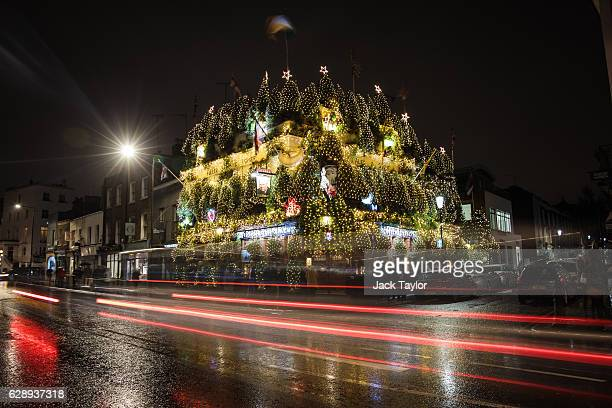 A general view of the Churchill Arms pub in Kensington on December 10 2016 in London England The Churchill Arms has been decorated with 90 conifers...