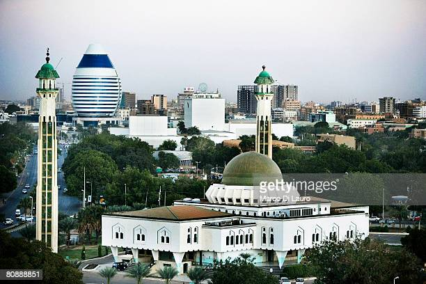 A general view of the city center and the As Sayed Ali Mosque and an innovative building shaped like a boat sail that will host a new hotel built by...