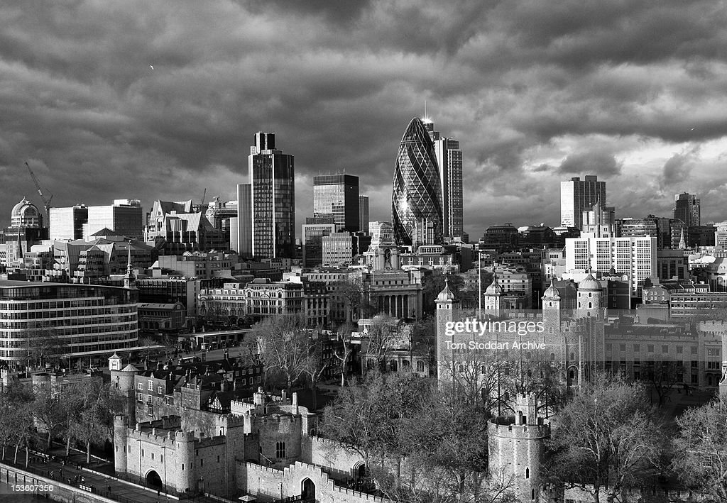 A general view of the City of London, or Square Mile, photographed from the top of the north tower of Tower Bridge. In the foreground is the Tower of London and behind is the Gherkin and Nat West Tower in the heart of the financial district.