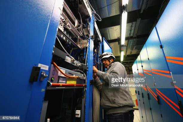 A general view of the CMS Electrical / Electronic Manufacturing Professional Imtiaz Ahmed working near the entrance to the cavern during a behind the...
