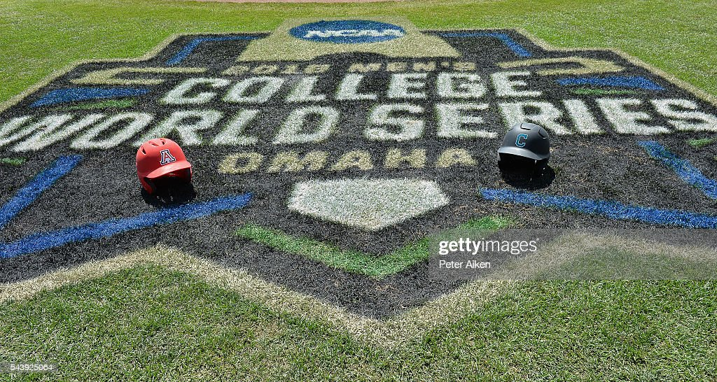 A general view of the College World Series logo and the Arizona Wildcats and the Coastal Carolina Chanticleers batting helmets prior to the start of game three of the College World Series Championship Series on June 30, 2016 at TD Ameritrade Park in Omaha, Nebraska.