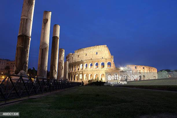 A general view of the Colossum at night taken from the Roman forum on the Palatino hill on March 31 2014 in Rome Italy