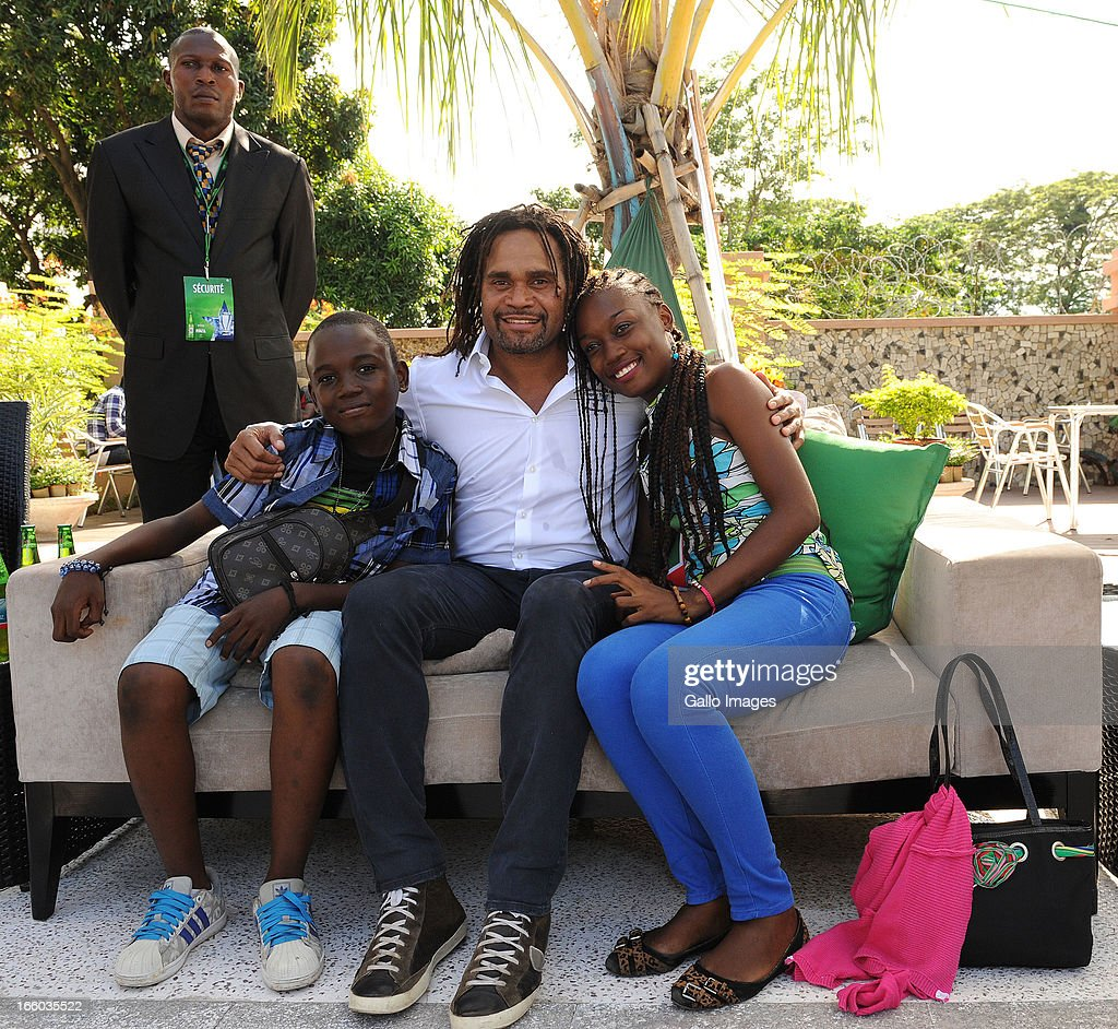 General view of the Consumer Trophy Tour and poses with Ambassadors Marcel Desailly and <a gi-track='captionPersonalityLinkClicked' href=/galleries/search?phrase=Christian+Karembeu&family=editorial&specificpeople=228704 ng-click='$event.stopPropagation()'>Christian Karembeu</a> during the UEFA Champions League Trophy Tour at Fleuve Congo Hotel on April 6, 2013 in Kinshasa, Democratic Republic Of Congo.