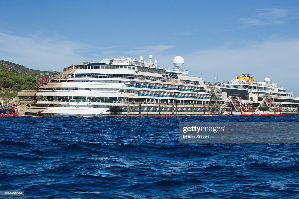 A general view of the Costa Concordia cruise ship in upright position on September 18, 2013 in Isola del Giglio, Italy. The vessel, which sank on January 12, 2012, was successfully righted during a painstaking operation yesterday morning. The ship will eventually be towed away and scrapped. It was the first time the procedure, known as parbuckling, had been carried out on a vessel as large as Costa Concordia.