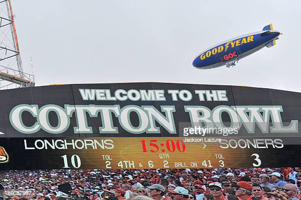 A general view of the Cotton Bowl scoreboard as the GoodYear blimp flies over the stadium during the Red River Shootout between the Oklahoma Sooners...