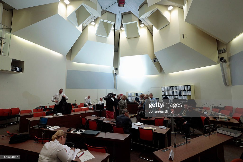 General view of the court room seen prior to the trial during day 18 of the NSU neo-Nazis murder trial at the Oberlandgericht Muenchen court on July 3, 2013 in Munich, Germany. Beate Zschaepe is the main defendant and is on trial for her role in assisting Uwe Boehnhardt and Uwe Mundlos in the murder of nine immigrants and one policewoman across Germany between 2000 and 2007. Together the trio called themselves the NSU, or National Socialist Underground, and were able to operate unbeknownst to police until Mundlos and Boehnhardt were cornered in 2011 after the two robbed a bank. Four other co-defendants, including Ralf Wohlleben, Holder G., Carsten S. and Andre E., are accused of assisting the trio. Carsten S. and Holger G. have declared themselves willing to give limited testimonies, while Zschaepe has thus far remained silent and refuses to answer any questions by the court.