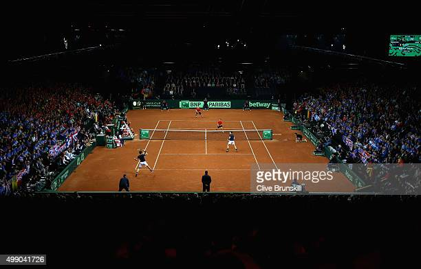 A general view of the court showing Steve Darcis and David Goffin of Belgium in action against Andy Murray and Jamie Murray of Great Britain during...