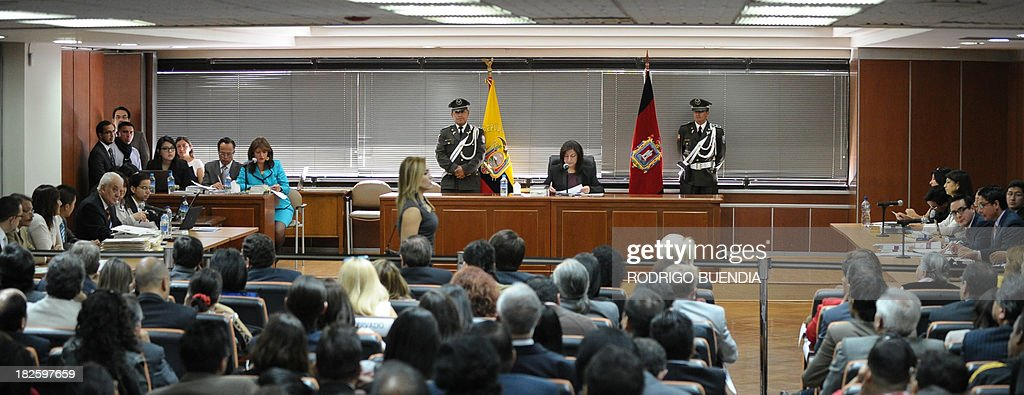A general view of the courtroom during a hearing where Ecuadorean Attorney General Galo Chiriboga (5-L) presented charges against military officers in Quito on October 1, 2103. Six generals and four coronels are accused of crimes against humanity during the government of Leon Febres-Cordero (1984-1988).