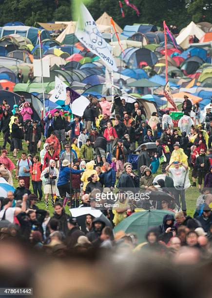 A general view of the crowd and tents at the Glastonbury Festival at Worthy Farm Pilton on June 26 2015 in Glastonbury England Now its 45th year the...