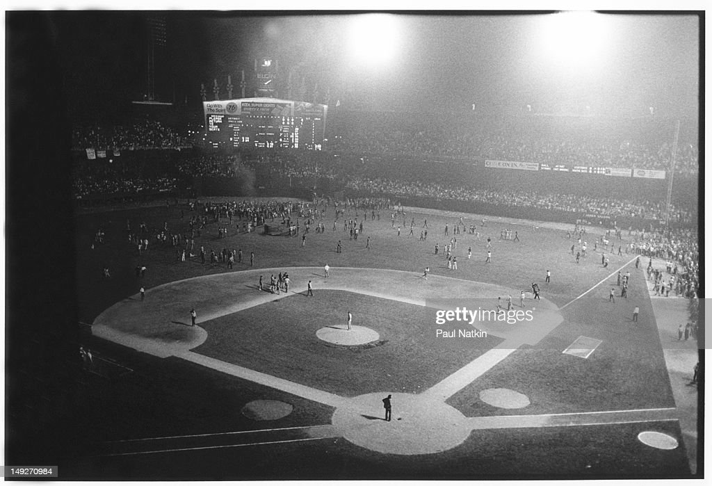 General view of the crowd as they storm the field at Comiskey Park during an antidisco promotion Chicago Illinois July 12 1979 The event held between...