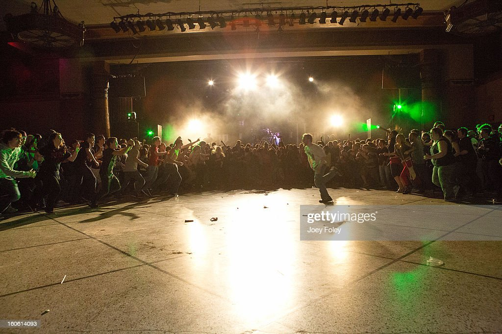 A general view of the crowd doing the 'wall of death' as the band The Used performs onstage at the Murat Egyptian Room on January 20, 2013 in Indianapolis, Indiana.
