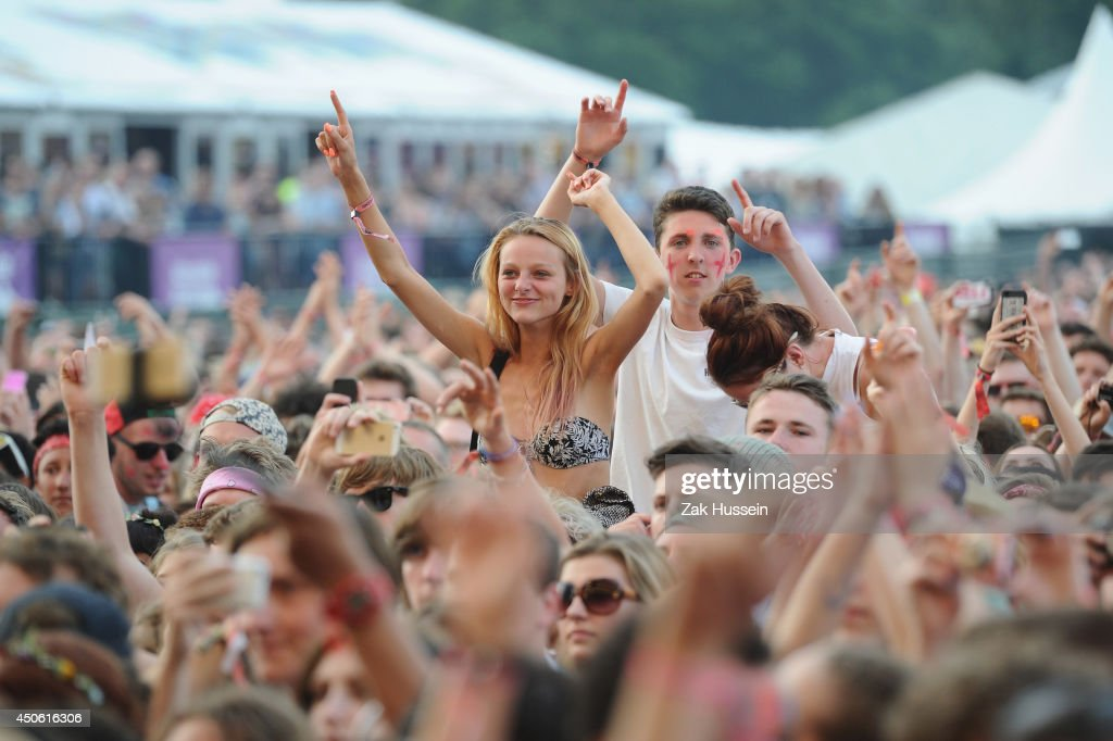 A general view of the crowd during 'The 1975' performance at The Isle of Wight Festival at Seaclose Park on June 14 2014 in Newport Isle of Wight