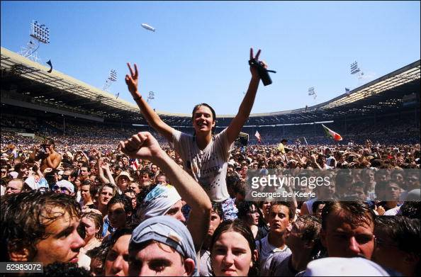 A general view of the crowd during the Live Aid concert at Wembley Stadium on 13 July 1985 in London England Live Aid was watched by millions around...