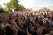 A general view of the crowd in front of the 'Monster Energy Stage' as the metalcore band 'Every Time I Die' performs onstage during the 2012 Vans...