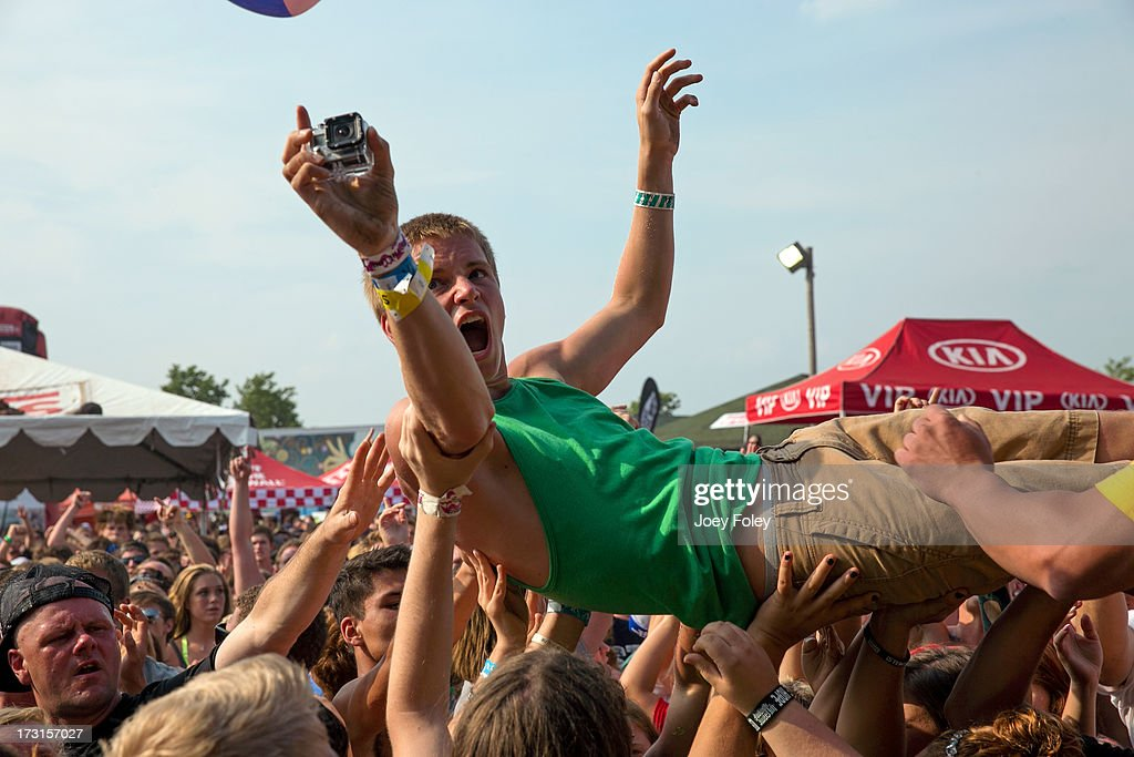 A general view of the crowd while a crowd surfer holding a Go!Cam performs during the Vans Warped Tour 2013 at Klipsch Music Center on July 3, 2013 in Noblesville, Indiana.