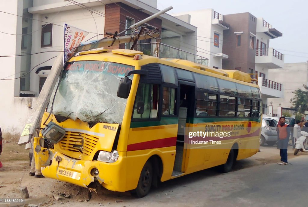 A general view of the damage after a school bus crashed into a electricity poll and four cars on February 6, 2012 at sector 27 in Gurgaon, India. A school bus traveling to Suncity World School carrying approximately 30 children, lost control and crashed into a electricity poll around 8 am on Monday. No injuries have been reported.